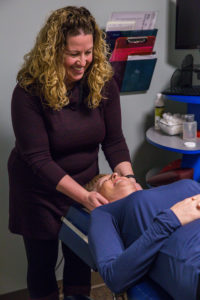 Dr. Cait at Absolute Health Chiropractic adjusts patient